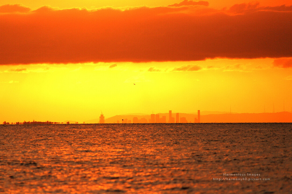 CITY IN THE SUN  The city of Brisbane view across the bay from Amity Point, North Stradbroke Island.   #city #Brisbane #sunset #MoretonBay #Australia
